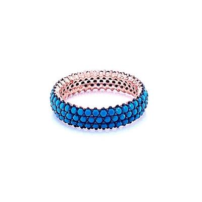 Obrączka z błękitnymi kamieniami